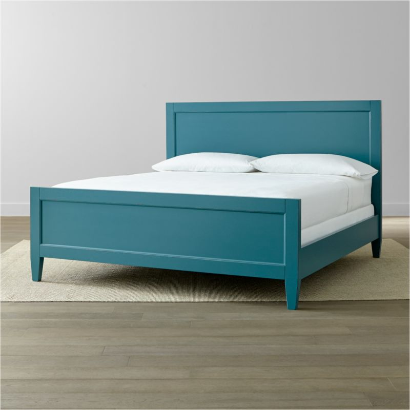 Our relaxed, inviting Harbor king bed evokes the simple pleasures of days at the shore with its soft blue finish hand-distressed by Italian master craftsmen. Styled with simple lines, this casual, modern bed's recessed headboard and footboard panels and tapered legs are treated to an artisanal finish in a multistep process of handpainting and hand-distressing to create the warm, relaxed appeal. The Harbor Blue King Bed is a Crate and Barrel exclusive.<br /><br /><NEWTAG/><ul><li>Tulipwood solids and engineered wood</li><li>Hand-applied blue water-based paint sealed with a beeswax finish</li><li>Naturally expands and contracts with changes in humidity</li><li>4 slats and 3 support legs</li><li>Mattresses and box springs also available (sold separately)</li><li>Maximum weight capacity: 800 lbs. (includes weight of mattress, box spring and occupants)</li><li>Made in Italy</li></ul>