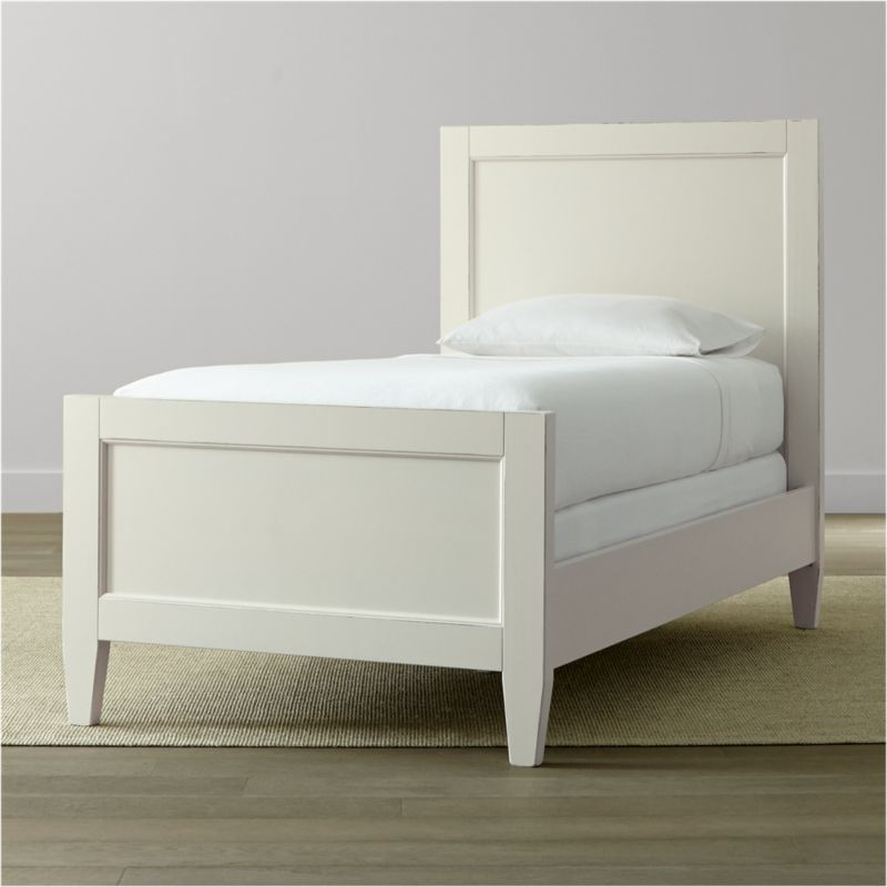 Casual and modern with simple lines, our Harbor twin bed evokes the simple pleasures of days at the shore. Relaxed and inviting, this twin bed features recessed head and footboard panels and tapered legs, all given a warm, aged patina by Italian master craftsmen. <NEWTAG/><ul><li>Solid Tulip wood and engineered wood</li><li>Hand-applied white water-based paint sealed with a beeswax finish</li><li>Naturally expands and contracts with changes in humidity</li><li>3 slats, 2 with feet</li><li>Mattresses and box springs also available (sold separately)</li><li>Maximum weight capacity: 350 lbs. (includes weight of mattress, box spring and occupants)</li><li>Made in Italy</li></ul>