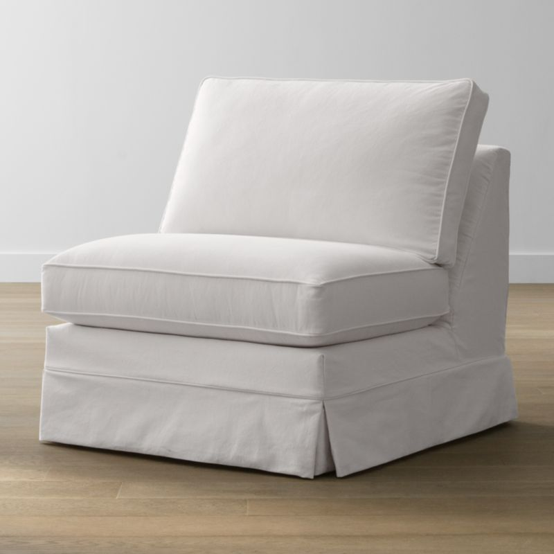 Keep your Harborside sectional armless chair looking as fresh as the day you brought it home with this convenient, carefree replacement slipcover. Fitted cotton-blend slipcover is tailored with crisp inverted kick pleats and self-welting to keep it neatly in place. Harborside Armless Chair Replacement Slipcover is a Crate and Barrel exclusive.<br /><br /><NEWTAG/><ul><li>Removable slipcover is machine washable</li><li>Self-welting</li><li>Material origin: see swatch</li><li>Made in North Carolina, USA</li></ul>