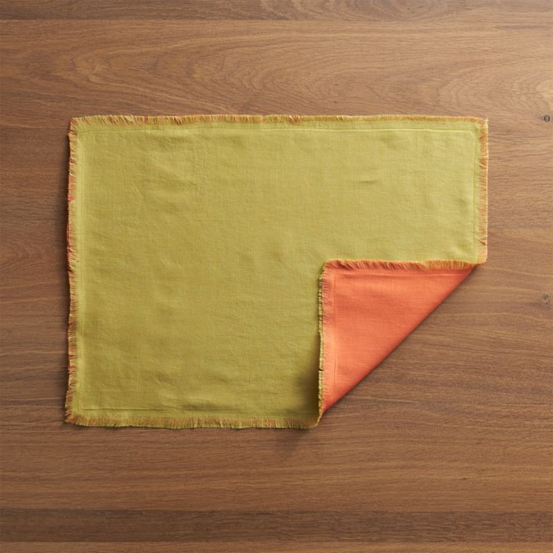 Reversible linen placemat sets a vibrant backdrop in your choice of dinnerware-friendly hues, pre-washed for extra softness and finished with fringed edges.<br /><br /><NEWTAG/><ul><li>100% linen</li><li>Machine wash cold, dry flat</li><li>Made in India</li></ul><br />