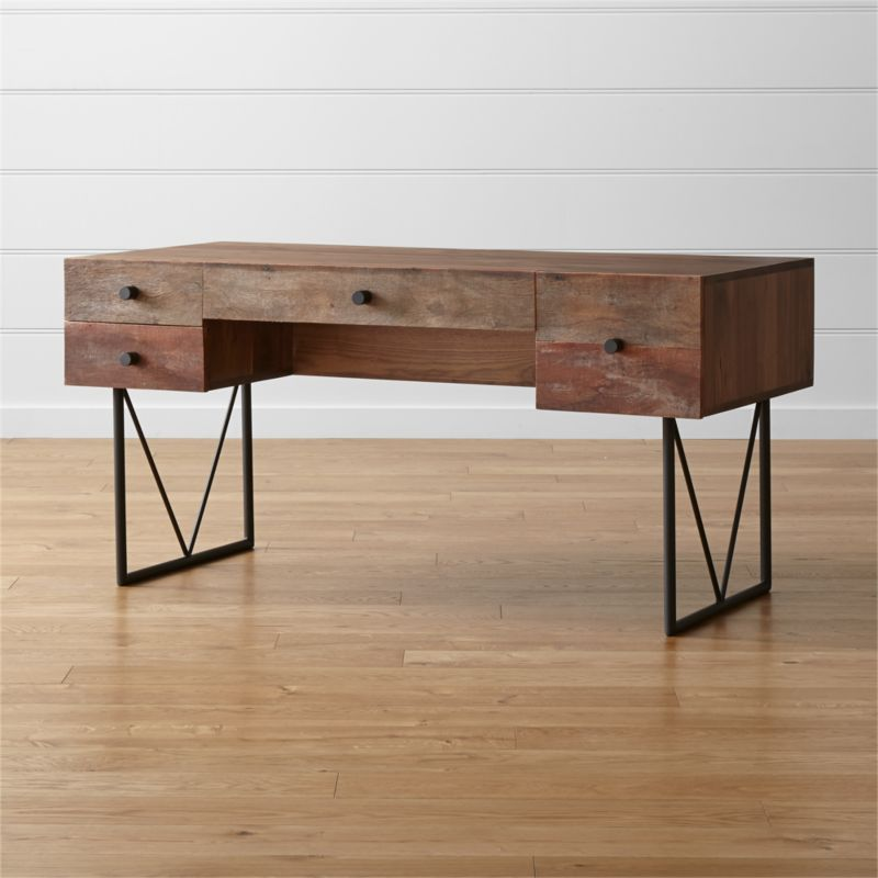 The rustic yet contemporary Hendrix Desk lends one-of-a-kind character to a home office, blending a hand-assembled, reclaimed peroba wood façade with a clean black walnut frame and top. An open back surprises with a display shelf for books and objects. <NEWTAG/><ul><li>Reclaimed peroba wood with clear sealer and wax topcoat</li><li>Solid black walnut with lacquer topcoat</li><li>Wood characteristics will vary</li><li>Naturally expands and contracts with changes in humidity</li><li>Welded steel base with black finish</li><li>Four drawers with iron pulls</li><li>Open back shelf</li><li>Metal glides with auto-soft close</li><li>Made in Mexico</li></ul><br />