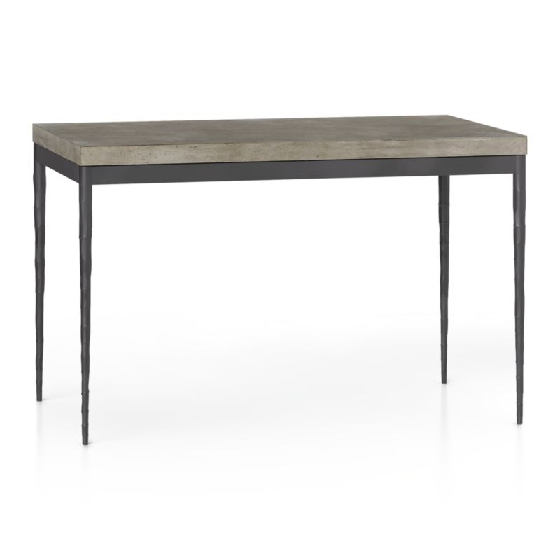 Start with a great base. Top it off with an eye-catching top. Voila—the perfect table. Slim tapered legs accentuate the graceful profile of the steel base, hammered to resemble artisanal metalsmithing. A dark finish and a wash coat of epoxy enhances its sculptural appeal. Seats four.<br /><br />Gorgeous warm grey concrete top mixes up a global compound sourced in Vietnam—marble, stone and granite from the mountainous Dalat region and grassy fibers from the Mekong Delta for added strength. Clean and modern material is also eco-friendly, handmade in shops powered without fossil fuels. Due to the handmade nature of the concrete mix, color will vary and may change over time.<br /><br /><NEWTAG/><ul><li>Steel with dark stain, epoxy wash coat and clear polyurethane topcoat</li><li>Handmade concrete of stone, marble, granite and natural fibers</li><li>Eco-friendly manufacture</li><li>Seats four</li><li>Do not leave spills unattended; wipe with damp cloth and dry</li><li>Made in Vietnam</li></ul>