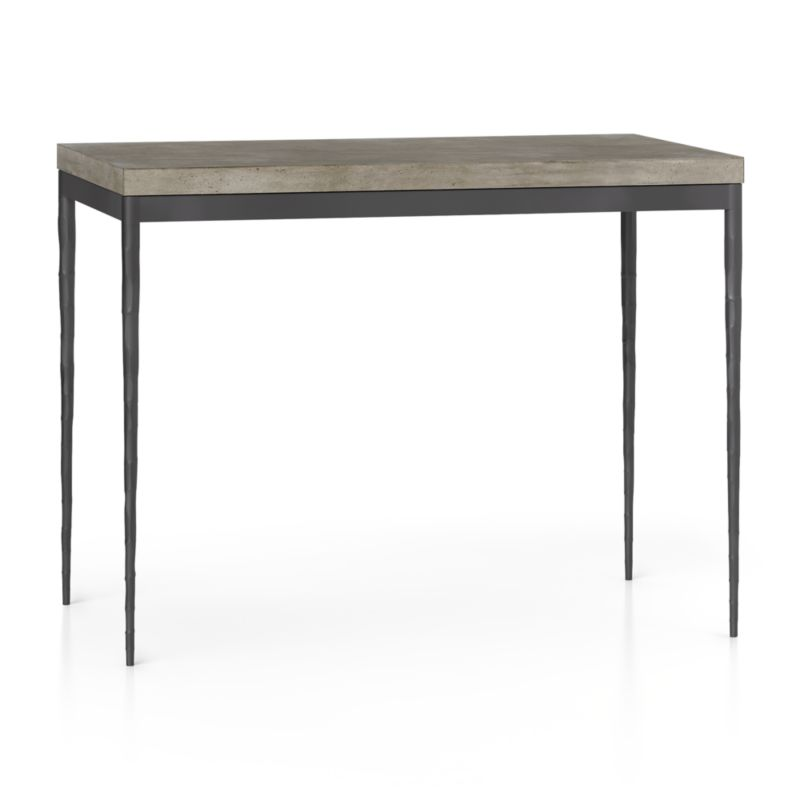 """You've designed your ideal table, from top to bottom in just the right size. The warm grey concrete top is a mix of marble, stone and granite powders with natural fibers for added strength. This industrial, modern surface is handmade in an eco-friendly shop powered without fossil fuels. Due to the handmade nature of the concrete mix, color will vary and may change over time. Slim tapered legs accentuate the graceful profile of the steel base, hammered to resemble artisanal metalsmithing. A dark finish and a protective top coat enhance its sculptural appeal. Counter-height high dining table seats up to 4. The Concrete Top/Hammered Base 48""""x28"""" High Dining Table is a Crate and Barrel exclusive.<br /><br /><br /><NEWTAG/><ul><li>Handmade concrete top of stone, marble, granite and natural fibers</li><li>Hairline fractures and slight tolerance for fit to base are characteristics of the concrete</li><li>Steel base with dark finish and clear polyurethane topcoat</li><li>Levelers</li><li>Accommodates counter stools</li><li>Seats 4</li><li>Made in Vietnam</li></ul>"""