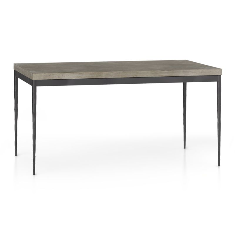 Start with a great base. Top it off with an eye-catching top. Voila—the perfect table. Slim tapered legs accentuate the graceful profile of the steel base, hammered to resemble artisanal metalsmithing. A dark finish and a wash coat of epoxy enhances its sculptural appeal. Seats six.<br /><br />Gorgeous warm grey concrete top mixes up a global compound sourced in Vietnam—marble, stone and granite from the mountainous Dalat region and grassy fibers from the Mekong Delta for added strength. Clean and modern material is also eco-friendly, handmade in shops powered without fossil fuels. Due to the handmade nature of the concrete mix, color will vary and may change over time.<br /><br /><NEWTAG/><ul><li>Steel with dark stain, epoxy wash coat and clear polyurethane topcoat</li><li>Handmade concrete of stone, marble, granite and natural fibers</li><li>Eco-friendly manufacture</li><li>Seats six</li><li>Do not leave spills unattended; wipe with damp cloth and dry</li><li>Made in Vietnam</li></ul>