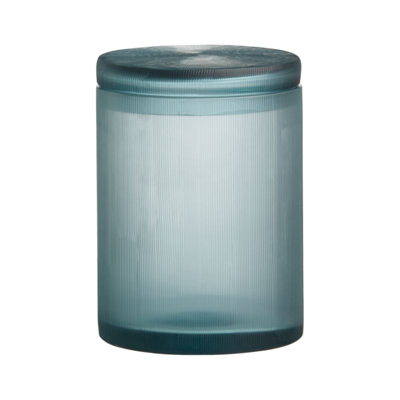 Translucent cerulean blue glass bath accessories shimmer seaside color and artisan craftsmanship, delicately textured with hand-carved fine lines. Clean, lidded jar keeps cotton balls, swabs, bath salts and other bathroom necessities near at hand and softly in view.<br /><br /><NEWTAG/><ul><li>Handcrafted</li><li>Glass</li><li>Wipe clean with damp cloth</li><li>Made in India</li></ul>