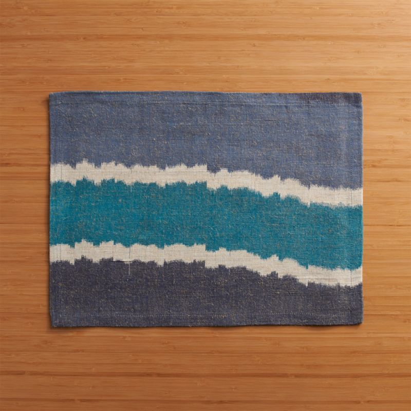 Assymetrical ikat weaves modern, ethnic stripes in vibrant tonal waves of blue jute-cotton yarns.<br /><br /><NEWTAG/><ul><li>65% jute and 355 cotton</li><li>Oversized to allow for shrinkage</li><li>Machine wash cold, line dry; hot iron as needed</li><li>Made in India</li></ul>