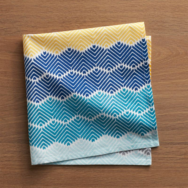 Inspired by Punjab phulkaris, festive women's garments worn for wedding ceremonies and other joyous gatherings, this vibrant napkin features an elaborate, all-over design of tonal blue, yellow and neutral waves.<br /><br /><NEWTAG/><ul><li>100% cotton</li><li>Do not dry clean or bleach</li><li>Machine wash cold, tumble dry; warm iron as needed</li><li>Made in India</li></ul>