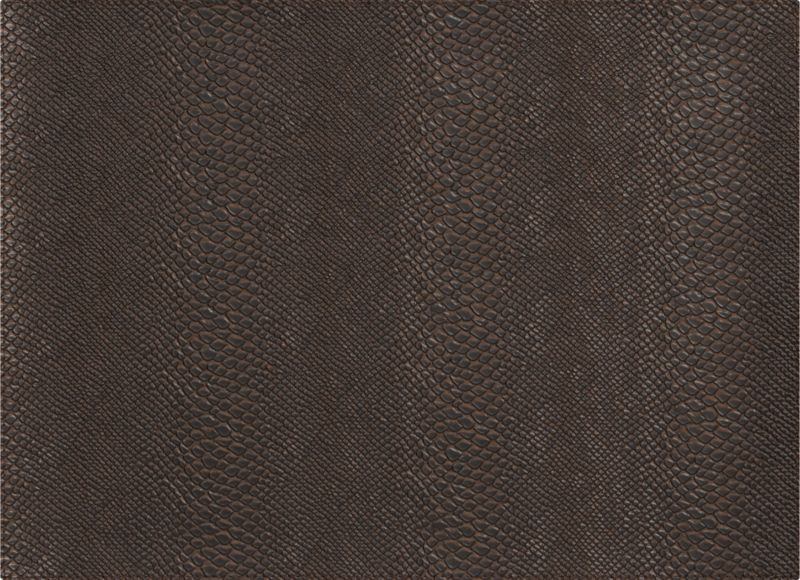 Snakeskin pattern charms like the real thing in easy-clean faux leather. Fool-the-eye texture in luxe bronze adds an exotic note to the table. Flocked backing protects table surfaces from scratches and spills.<br /><br /><NEWTAG/><ul><li>100% PVC faux leather</li><li>Flocked polyamide backing</li><li>Hand-cut and -sewn placemat</li><li>Clean with a damp cloth</li><li>Made in Turkey</li></ul>