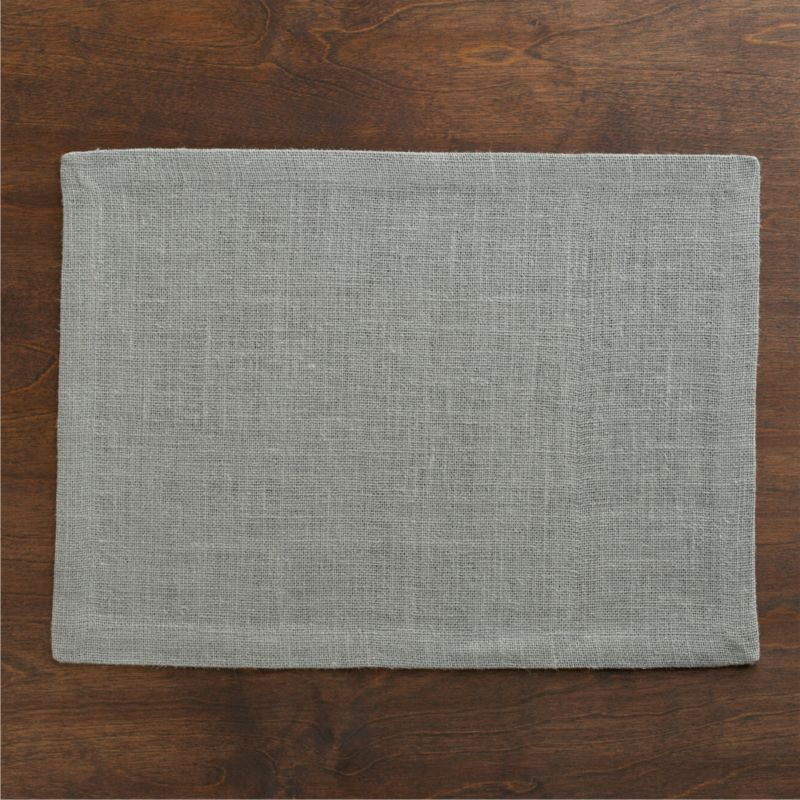 Casual jute attires in an open weave of cool grey with the relaxed style of unpressed linen. Placemat is tailored with a generous hem and mitered corners. Fiber will soften with each wash.<br /><br /><NEWTAG/><ul><li>Jute</li><li>Machine wash, reshape and dry flat; warm iron as needed</li><li>Made in India</li></ul>