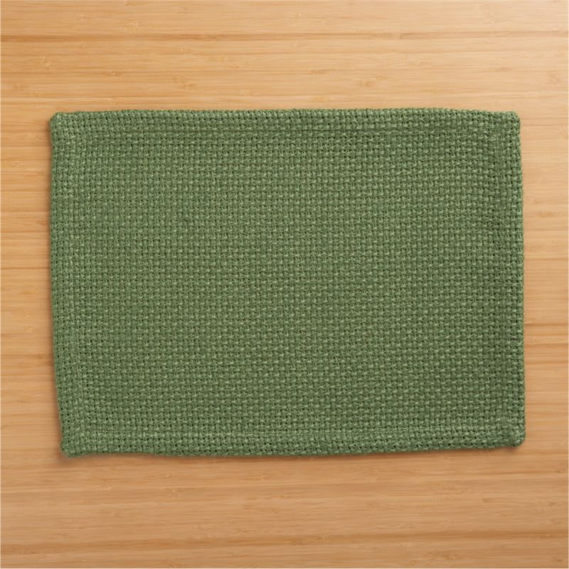 Tactile, beautiful jute shows off in a chunky, open weave placemat, setting a textural, solid green base for a range of colorful place settings.<br /><br /><NEWTAG/><ul><li>100% jute</li><li>Machine wash, dry flat; warm iron as needed</li><li>Made in India</li></ul>