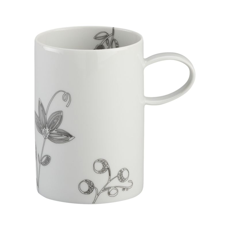 Inspired by traditional Portuguese embroidery, a new take on floral dinnerware scatters graphic black botanical sprigs across white porcelain pieces with classic coupe shapes and subtle ridge detail.<br /><br /><strong>Please note:</strong> This mug is discontinued. When our current inventory is sold out, it is unlikely we will be able to obtain more.<br /><br /><NEWTAG/><ul><li>Porcelain</li><li>Dishwasher-, microwave- and oven-safe to 350 degrees</li><li>Made in Portugal</li></ul><br /><br />