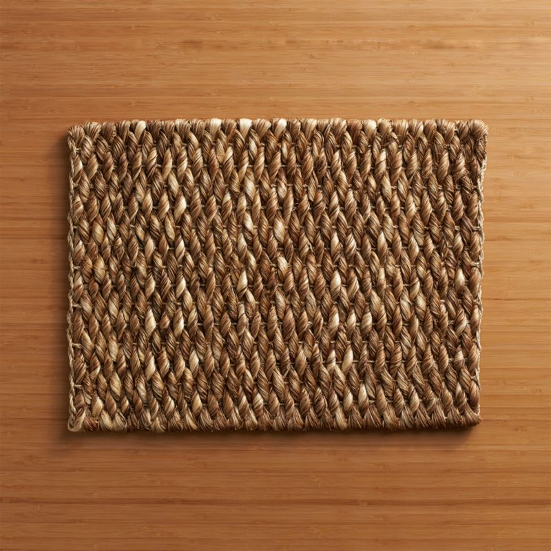 Natural abaca fibers are twisted and woven by hand to create this boldly textured placemat with rustic good looks and a touch of the tropics.<br /><br /><NEWTAG/><ul><li>Handcrafted</li><li>100% abaca fiber</li><li>Clean with a damp cloth</li><li>Made in The Philippines</li></ul>