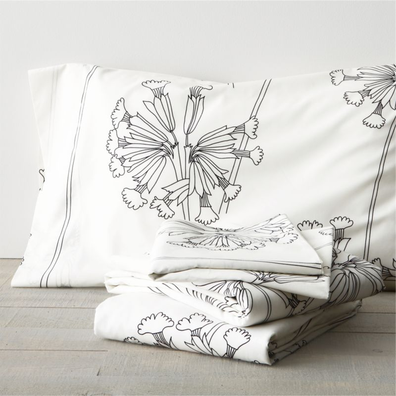 "While perusing an old botanical scrapbook, designer Erja Hirvi was struck by the structure of the cowslip (""Kevatesikko""), a flowering plant common to Europe. Her beautiful line drawings are a celebration of the plant's elegant form and intricate flowers, graphically rendered in black on crisp white. Generous fitted sheet pockets accommodate thicker mattresses. Flat sheet and cases have a 4"" hem. Sheet set includes one flat sheet, one fitted sheet and two king pillowcases. Bed pillows also available.<br /><br /><NEWTAG/><ul><li>Pattern designed by Erja Hirvi; 2011</li><li>100% cotton percale</li><li>300-thread-count</li><li>Machine wash cold</li><li>Made in Pakistan</li></ul>"