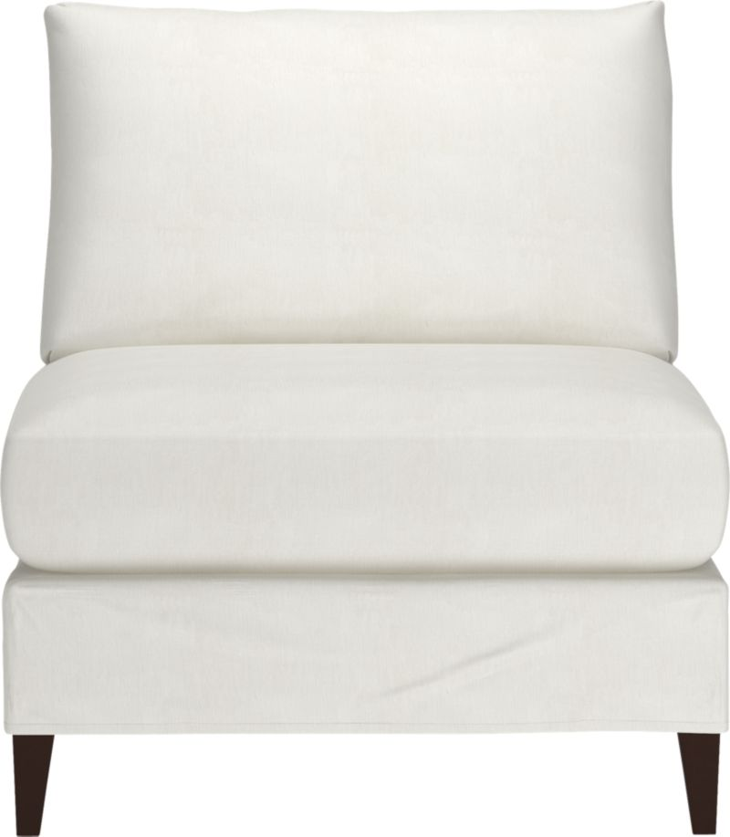 "Klyne is compact seating styled sleek yet roomy, refreshing apartments and small spaces with modern good looks and casual comfort. Chic, tailored slipcover hugs its frame and plump cushions in snowy cotton-poly, with a trim, short skirt to show off its tapered legs.<br /><br />Additional <a href=""http://crateandbarrel.custhelp.com/cgi-bin/crateandbarrel.cfg/php/enduser/crate_answer.php?popup=-1&p_faqid=125&p_sid=DMUxFvPi"">slipcovers</a> available below and through stores featuring our Furniture Collection.<br /><br />After you place your order, we will send a fabric swatch via next day air for your final approval. We will contact you to verify both your receipt and approval of the fabric swatch before finalizing your order.<br /><br /><NEWTAG/><ul><li>Eco-friendly construction</li><li>Certified sustainable kiln-dried hardwood frames</li><li>Seat cushion is soy- or plant-based polyfoam encased in synthetic ticking</li><li>Back cushion is fiber in synthetic ticking</li><li>Flexolator spring suspension</li><li>Hardwood legs with hickory finish</li><li>Slipcover is 89% cotton and 11% polyester</li><li>Machine wash the removable slipcovers</li><li>100% cotton muslin base fabric</li><li>Benchmade</li><li>See additional frame options below</li><li>Made in North Carolina, USA</li></ul>"