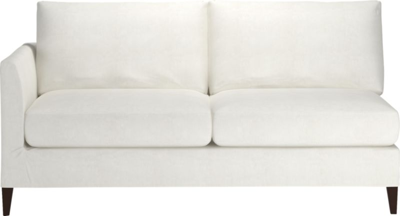 "Tailored to fit our Klyne seating, chic slipcover is fashioned slim and minimal to make the most of its narrow tapered arms, plump cushions and tapered legs.<br /><br />Additional <a href=""http://crateandbarrel.custhelp.com/cgi-bin/crateandbarrel.cfg/php/enduser/crate_answer.php?popup=-1&p_faqid=125&p_sid=DMUxFvPi"">slipcovers</a> available below and through stores featuring our Furniture Collection.<br /><br />After you place your order, we will send a fabric swatch via next day air for your final approval. We will contact you to verify both your receipt and approval of the fabric swatch before finalizing your order.<br /><br /><NEWTAG/><ul><li>89% cotton and 11% polyester</li><li>Ma"