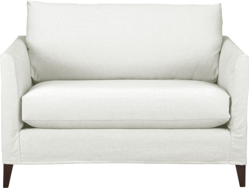 "Tailored to fit our Klyne seating, chic slipcover is fashioned slim and minimal to make the most of its narrow tapered arms, plump cushion and tapered legs.<br /><br />Additional <a href=""http://crateandbarrel.custhelp.com/cgi-bin/crateandbarrel.cfg/php/enduser/crate_answer.php?popup=-1&p_faqid=125&p_sid=DMUxFvPi"">slipcovers</a> available below and through stores featuring our Furniture Collection.<br /><br />After you place your order, we will send a fabric swatch via next day air for your final approval. We will contact you to verify both your receipt and approval of the fabric swatch before finalizing your order.<br /><br /><NEWTAG/><ul><li>89% cotton and 11% polyester</li><li>Machi"