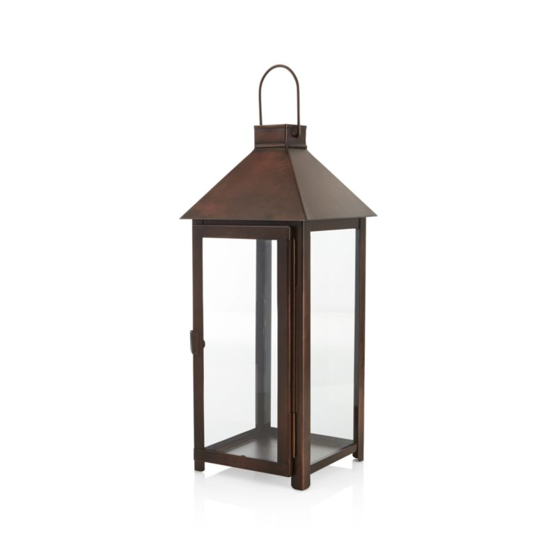 "The traditional lantern scales up and streamlines with a warm bronze finish that looks great in the home or outside on the patio. Clean and classic styling includes glass panels, a hinged door, and hanging handle. Tall, large-size lantern makes room for a tall pillar candle, up to six inches high.<br /><br /><NEWTAG/><ul><li>Iron with bronze finish</li><li>Glass panels</li><li>For indoor or outdoor use</li><li>Accommodates up to a 3""-diameter pillar candle, sold separately</li><li>Made in India</li></ul>"