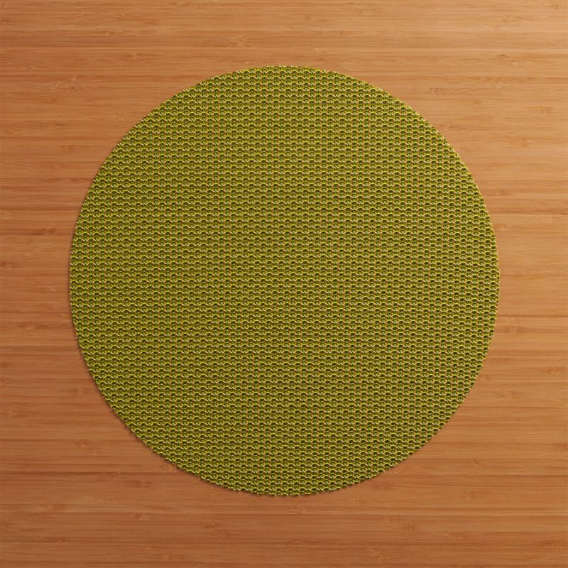 Durable polyester-vinyl placemat textures the table in an exclusive pattern that  takes its cue from fine knits.<br /><br /><NEWTAG/><ul><li>70% vinyl and 30% polyester</li><li>Clean with a damp cloth; air or towel dry and store flat</li><li>Made in USA</li></ul>