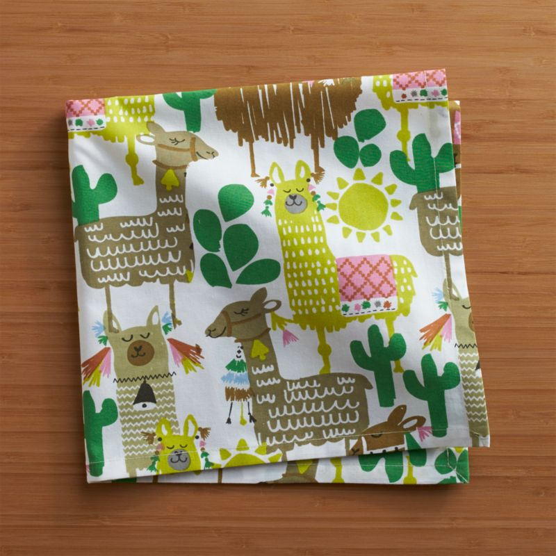 Festooned with fancy trappings, our proud pack of llamas struts south-of-the-boarder style on white cotton napkins. Coordinate this colorful and charming pattern with any number of solid-colored table linens.<br /><br /><NEWTAG/><ul><li>100% cotton</li><li>Machine wash cold, tumble dry; warm iron as needed</li><li>Do not dry clean or bleach</li><li>Made in India</li></ul>