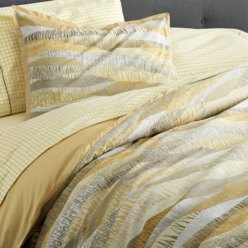 New horizons in tone and texture for the contemporary bed. Flowing landscapes with organic texturing are printed in a rich palette of golds and browns, beiges and greys to resemble an elaborate patchwork quilt. Duvet cover with stabilizing duvet ties reverses to solid sandy brown. Duvet inserts also available.<br /><br /><NEWTAG/><ul><li>100% cotton</li><li>180-thread-count</li><li>Machine wash, tumble dry low</li><li>Made in India</li></ul>