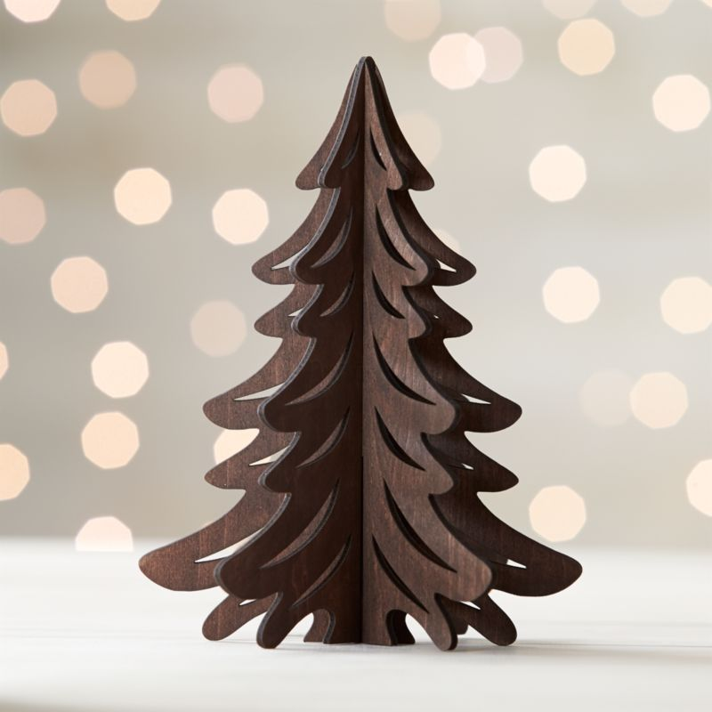 Graphic wood trees are laser-cut in realistic detail, easily assembled into dimensional, freestanding conversation pieces. Small tree with a dark finish can be paired with our laser-cut animals and village for a full decorative statement.<br /><br /><NEWTAG/><ul><li>Laser-cut plywood</li><li>Dark finish</li><li>Made in China</li></ul>