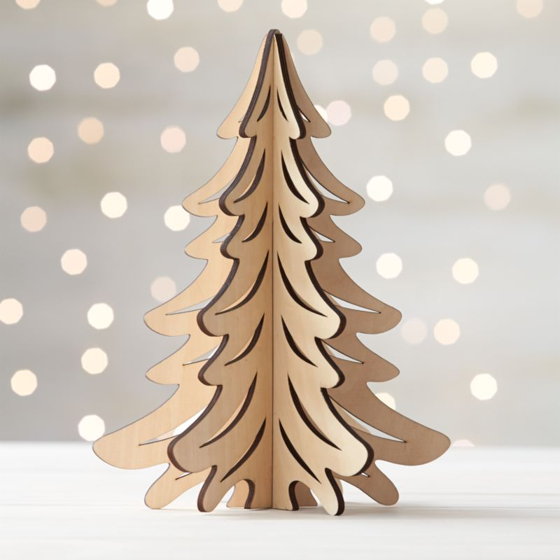 Graphic wood trees are laser-cut in realistic detail, easily assembled into dimensional, freestanding conversation pieces. Large tree with a natural finish can be paired with our laser-cut animals and village for a full decorative statement.<br /><br /><NEWTAG/><ul><li>Laser-cut plywood</li><li>Natural finish</li><li>Made in China</li></ul>