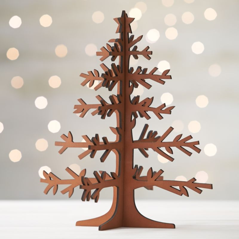 Graphic wood trees are laser-cut in realistic detail, easily assembled into dimensional, freestanding conversation pieces. Large tree with star top and mid-tone finish can be paired with our laser-cut animals and village for a full decorative statement.<br /><br /><NEWTAG/><ul><li>Laser-cut plywood</li><li>Mid-tone finish</li><li>Made in China</li></ul>