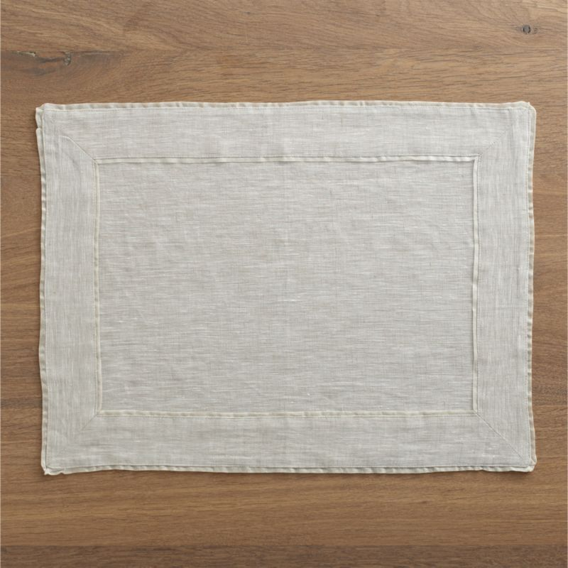 Natural linen placemat with a delicate silk tissue flange coordinates with any and every table setting.<br /><br /><NEWTAG/><ul><li>100% linen</li><li>Silk tissue flange</li><li>Machine wash, reshape and dry flat; warm iron as needed</li><li>Made in India</li></ul>