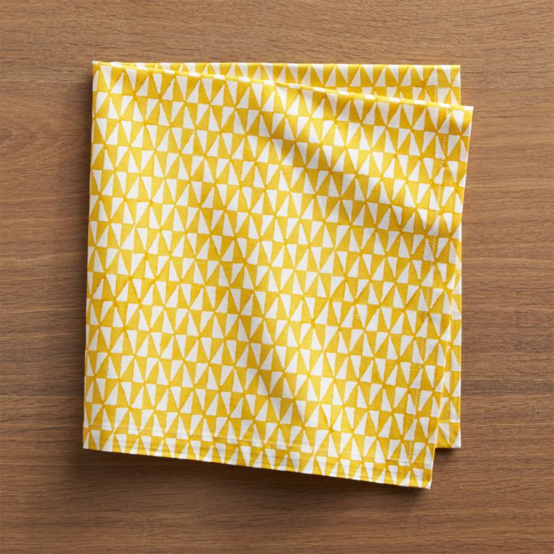 Handcarved wood blocks pattern yellow and white triangles for a cheerful, contemporary napkin. Due to its handcrafted nature, each napkin's patterning will vary slightly.<br /><br /><NEWTAG/><ul><li>Handcrafted</li><li>100% cotton</li><li>Machine wash napkin separately in cold water, dry flat; warm iron as needed</li><li>Do not dry clean or bleach</li><li>Made in India</li></ul>
