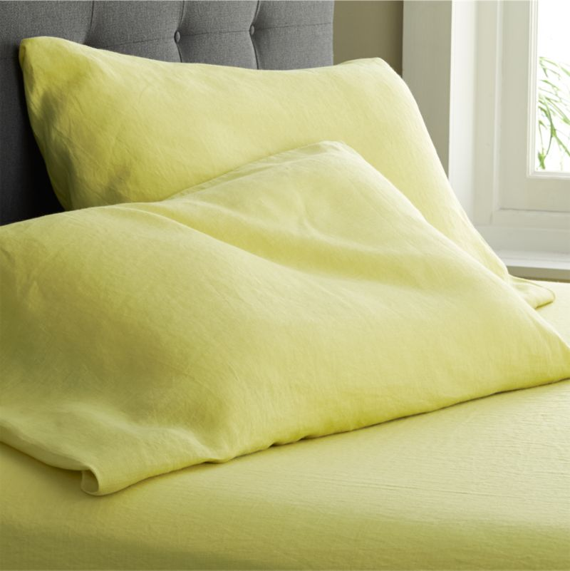 "Super soft, washed bedding in solid, gorgeous hues spreads the bed in the comforting touch and relaxed, worn-in style of pure linen. Cases have 3"" side pocket closures.<br />Due to the nature of linen, you will find slight variations in color, as well as fabric irregularities that come from the spinning or weaving process. The imperfections of the long and short fibers create knots and slubs in the weaving, giving this product a natural and unique look. These irregularities should not be considered imperfections, but rather the beauty of the linen fabric, one of the oldest natural fabrics in textiles.<br /><br /><NEWTAG/><ul><li>100% linen</li><li>3"" side pocket closure</li>"