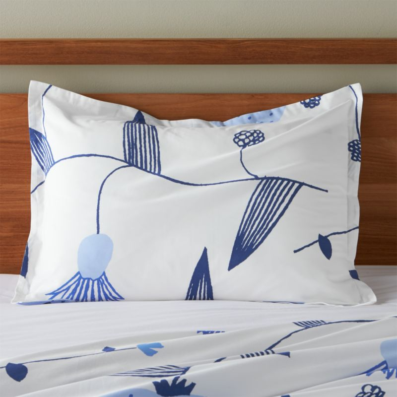 "Fujiwo Ishimoto's interpretation of the stark beauty of Finland's Lapland scatters line drawings of blue vines, leaves and flowers on crisp white cotton percale. Shams have 1"" flange and generous overlapping back closures. Bed pillows also available.<br /><br /><NEWTAG/><ul><li>Designed by Fujiwo Ishimoto</li><li>100% cotton percale</li><li>300-thread-count</li><li>Overlapping back closures</li><li>Machine wash cold, tumble dry low; warm iron as needed</li><li>Made in Pakistan</li></ul>"