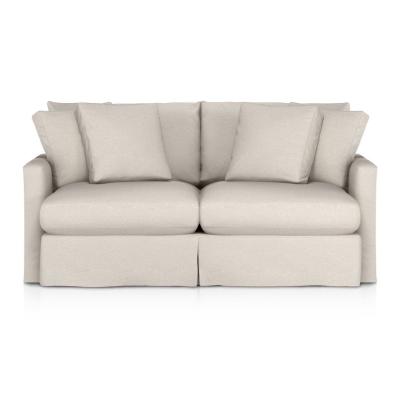 """Tailored to fit our Lounge Slipcovered Apartment Sofa, smart denim slipcover is tailored with a kickpleat skirt and jumbo double topstitch outlining its high slim arms and plump, deep cushions.<br /><br />Additional <a href=""""http://crateandbarrel.custhelp.com/cgi-bin/crateandbarrel.cfg/php/enduser/crate_answer.php?popup=-1&p_faqid=125&p_sid=DMUxFvPi"""">slipcovers</a> available below and through stores featuring our Furniture Collection.<br /><br />After you place your order, we will send a fabric swatch via next day air for your final approval. We will contact you to verify both your receipt and approval of the fabric swatch before finalizing your order.<br /><br /><NEWTAG/><ul><li>100% cotton</li><li>Machine washable</li><li>Jumbo contrast topstitching detail</li><li>Made in North Carolina, USA</li></ul><br />"""