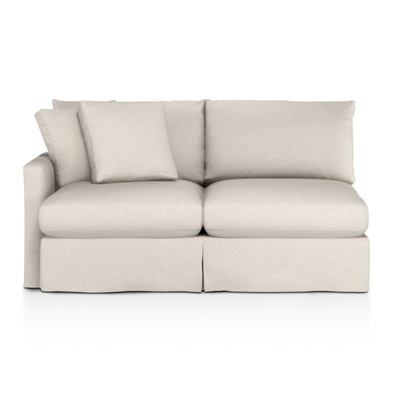 """Introducing a Casual Friday dress code for our popular, laid-back Lounge Collection. Smart denim slipcover is tailored with a kickpleat skirt and jumbo double topstitch outlining its high, slim arms and plump, deep cushions.<br /><br />Additional <a href=""""http://crateandbarrel.custhelp.com/cgi-bin/crateandbarrel.cfg/php/enduser/crate_answer.php?popup=-1&p_faqid=125&p_sid=DMUxFvPi"""">slipcovers</a> available below and through stores featuring our Furniture Collection.<br /><br />After you place your order, we will send a fabric swatch via next day air for your final approval. We will contact you to verify both your receipt and approval of the fabric swatch before finalizing your order.<br /><br /><NEWTAG/><ul><li>Eco-friendly construction</li><li>Certified sustainable, kiln-dried hardwood frame</li><li>Seat cushions are multi-layer soy- or plant-based poly foam wrapped in fiber down blend and encased in downproof ticking</li><li>Back cushions are fiber down in downproof ticking</li><li>100% cotton slipcover</li><li>Removable slipcovers are machine washable</li><li>Jumbo contrast topstitching detail</li><li>Flexolator spring suspension</li><li>Benchmade</li><li>See additional frame options below</li><li>Made in North Carolina, USA</li></ul>"""