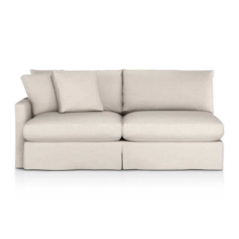 """Tailored to fit our Lounge Slipcovered Left Arm Sofa, smart denim slipcover is tailored with a kickpleat skirt and jumbo double topstitch outlining its high slim arm and plump, deep cushions.<br /><br />Additional <a href=""""http://crateandbarrel.custhelp.com/cgi-bin/crateandbarrel.cfg/php/enduser/crate_answer.php?popup=-1&p_faqid=125&p_sid=DMUxFvPi"""">slipcovers</a> available below and through stores featuring our Furniture Collection.<br /><br />After you place your order, we will send a fabric swatch via next day air for your final approval. We will contact you to verify both your receipt and approval of the fabric swatch before finalizing your order.<br /><br /><NEWTAG/><ul><li>100% cotton</li><li>Machine washable</li><li>Jumbo contrast topstitching detail</li><li>Made in North Carolina, USA</li></ul><br />"""