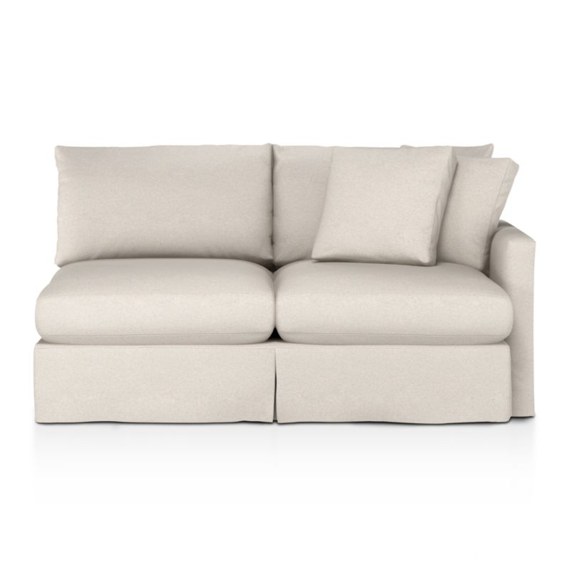 """Tailored to fit our Lounge Slipcovered Right Arm Apartment Sofa, smart denim slipcover is tailored with a kickpleat skirt and jumbo double topstitch outlining its high slim arm and plump, deep cushions.<br /><br />Additional <a href=""""http://crateandbarrel.custhelp.com/cgi-bin/crateandbarrel.cfg/php/enduser/crate_answer.php?popup=-1&p_faqid=125&p_sid=DMUxFvPi"""">slipcovers</a> available below and through stores featuring our Furniture Collection.<br /><br />After you place your order, we will send a fabric swatch via next day air for your final approval. We will contact you to verify both your receipt and approval of the fabric swatch before finalizing your order.<br /><br /><NEWTAG/><ul><li>100% cotton</li><li>Machine washable</li><li>Jumbo contrast topstitching detail</li><li>Made in North Carolina, USA</li></ul><br />"""