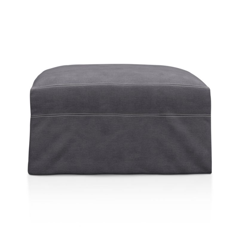 "Tailored to fit our Lounge Slipcovered Ottoman, smart denim slipcover is tailored with a kickpleat skirt and jumbo double topstitch outlining.<br /><br />Additional <a href=""http://crateandbarrel.custhelp.com/cgi-bin/crateandbarrel.cfg/php/enduser/crate_answer.php?popup=-1&p_faqid=125&p_sid=DMUxFvPi"">slipcovers</a> available below and through stores featuring our Furniture Collection.<br /><br />After you place your order, we will send a fabric swatch via next day air for your final approval. We will contact you to verify both your receipt and approval of the fabric swatch before finalizing your order.<br /><br /><NEWTAG/><ul><li>100% cotton</li><li>Machine washable</li><li>Jumbo contrast topstitching detail</li><li>Made in North Carolina, USA</li></ul><br /><br />"