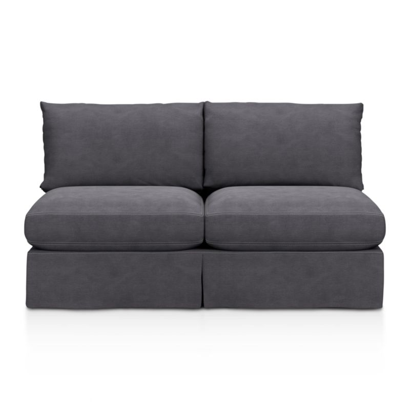 "Introducing a Casual Friday dress code for our popular, laid-back Lounge Collection. Smart denim slipcover is tailored with a kickpleat skirt and jumbo double topstitch outlining its plump, deep cushions.<br /><br />Additional <a href=""http://crateandbarrel.custhelp.com/cgi-bin/crateandbarrel.cfg/php/enduser/crate_answer.php?popup=-1&p_faqid=125&p_sid=DMUxFvPi"">slipcovers</a> available below and through stores featuring our Furniture Collection.<br /><br />After you place your order, we will send a fabric swatch via next day air for your final approval. We will contact you to verify both your receipt and approval of the fabric swatch before finalizing your order.<br /><br /><NEWTAG/><ul><li>Eco-friendly construction</li><li>Certified sustainable, kiln-dried hardwood frame</li><li>Seat cushions are multi-layer soy- or plant-based poly foam wrapped in fiber down blend and encased in downproof ticking</li><li>Back cushions are fiber down in downproof ticking</li><li>100% cotton slipcover</li><li>Removable slipcovers are machine washable</li><li>Jumbo contrast topstitching detail</li><li>Flexolator spring suspension</li><li>Benchmade</li><li>See additional frame options below</li><li>Made in North Carolina, USA</li></ul>"