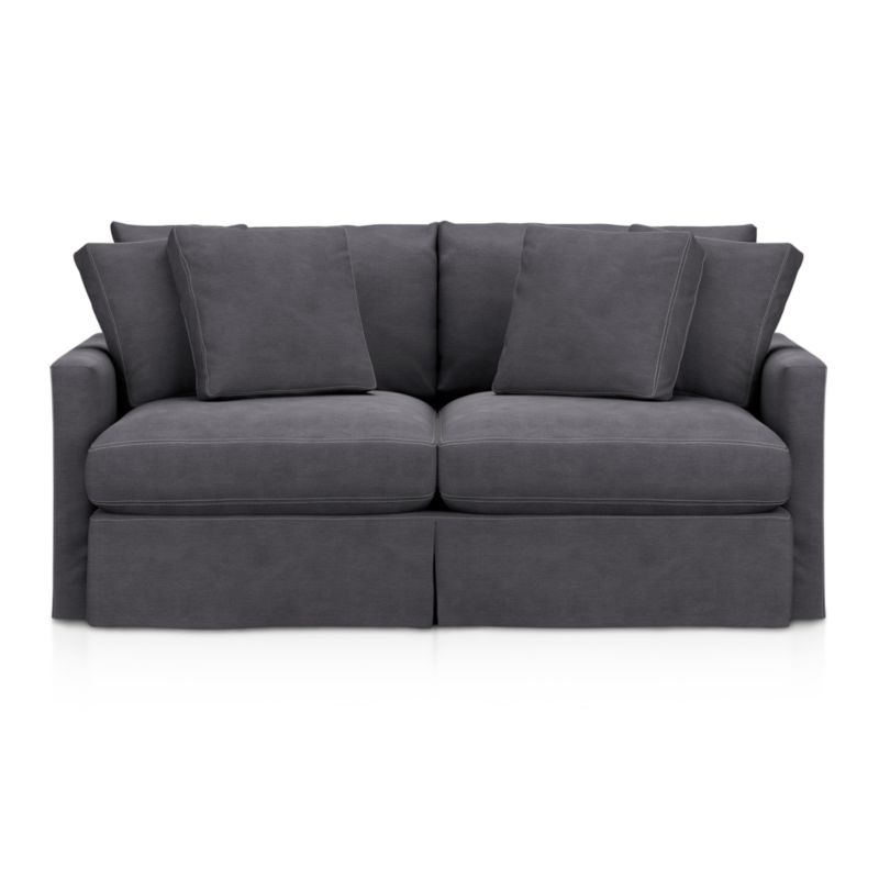 "Tailored to fit our Lounge Slipcovered Apartment Sofa, smart denim slipcover is tailored with a kickpleat skirt and jumbo double topstitch outlining its high slim arms and plump, deep cushions.<br /><br />Additional <a href=""http://crateandbarrel.custhelp.com/cgi-bin/crateandbarrel.cfg/php/enduser/crate_answer.php?popup=-1&p_faqid=125&p_sid=DMUxFvPi"">slipcovers</a> available below and through stores featuring our Furniture Collection.<br /><br />After you place your order, we will send a fabric swatch via next day air for your final approval. We will contact you to verify both your receipt and approval of the fabric swatch before finalizing your order.<br /><br /><NEWTAG/><ul><li>100% cotton</li><li>Machine washable</li><li>Jumbo contrast topstitching detail</li><li>Made in North Carolina, USA</li></ul><br />"