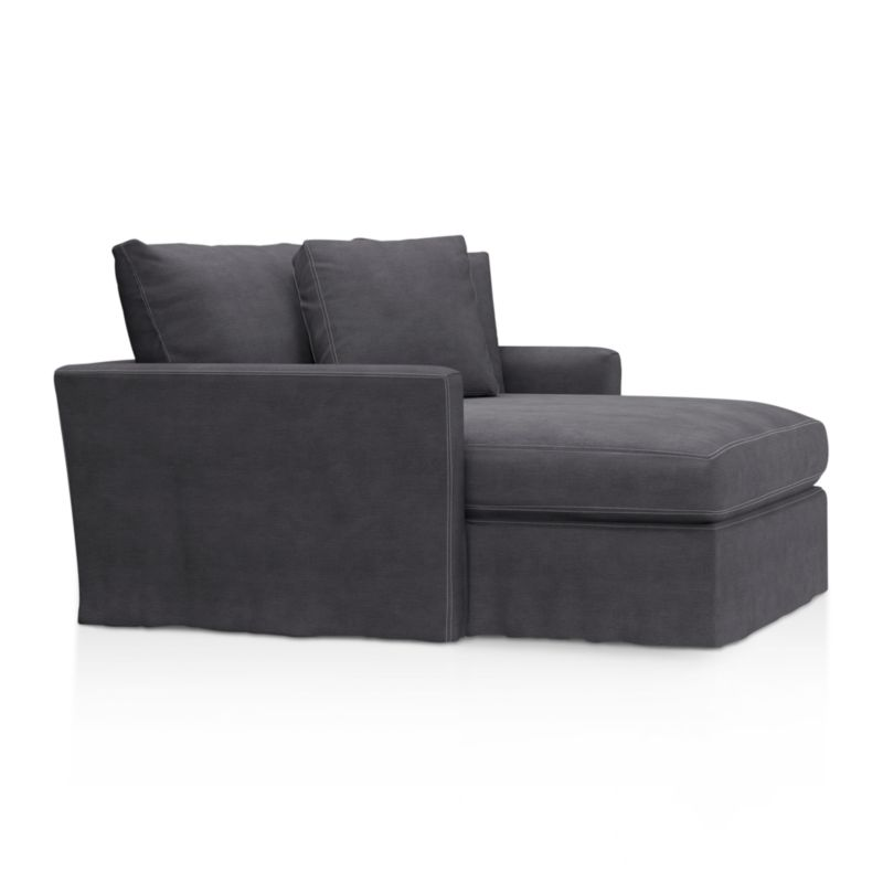"""Tailored to fit our Lounge Slipcovered Chaise, smart denim slipcover is tailored with a kickpleat skirt and jumbo double topstitch outlining its high slim arms and plump, deep cushions.<br /><br />Additional <a href=""""http://crateandbarrel.custhelp.com/cgi-bin/crateandbarrel.cfg/php/enduser/crate_answer.php?popup=-1&p_faqid=125&p_sid=DMUxFvPi"""">slipcovers</a> available below and through stores featuring our Furniture Collection.<br /><br />After you place your order, we will send a fabric swatch via next day air for your final approval. We will contact you to verify both your receipt and approval of the fabric swatch before finalizing your order.<br /><br /><NEWTAG/><ul><li>100% cotton</li><li>Machine washable</li><li>Jumbo contrast topstitching detail</li><li>Made in North Carolina, USA</li></ul><br />"""