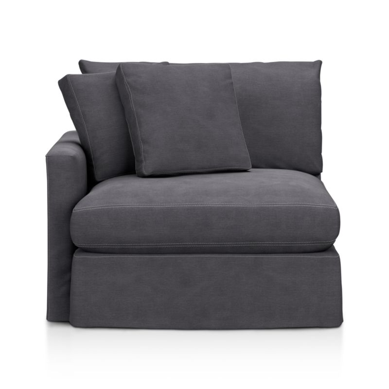 """Tailored to fit our Lounge Slipcovered Left Arm Chair, smart denim slipcover is tailored with a kickpleat skirt and jumbo double topstitch outlining its high slim arm and plump, deep cushions.<br /><br />Additional <a href=""""http://crateandbarrel.custhelp.com/cgi-bin/crateandbarrel.cfg/php/enduser/crate_answer.php?popup=-1&p_faqid=125&p_sid=DMUxFvPi"""">slipcovers</a> available below and through stores featuring our Furniture Collection.<br /><br />After you place your order, we will send a fabric swatch via next day air for your final approval. We will contact you to verify both your receipt and approval of the fabric swatch before finalizing your order.<br /><br /><NEWTAG/><ul><li>100% cotton</li><li>Machine washable</li><li>Jumbo contrast topstitching detail</li><li>Made in North Carolina, USA</li></ul><br />"""