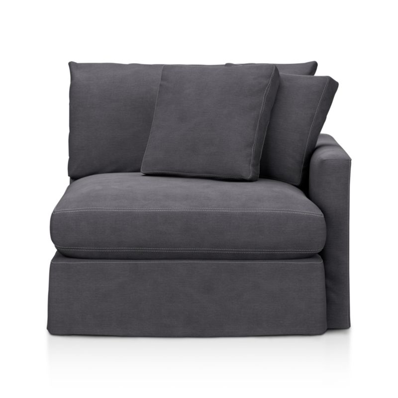 "Tailored to fit our Lounge Slipcovered Right Arm Chair, smart denim slipcover is tailored with a kickpleat skirt and jumbo double topstitch outlining its high slim arm and plump, deep cushions.<br /><br />Additional <a href=""http://crateandbarrel.custhelp.com/cgi-bin/crateandbarrel.cfg/php/enduser/crate_answer.php?popup=-1&p_faqid=125&p_sid=DMUxFvPi"">slipcovers</a> available below and through stores featuring our Furniture Collection.<br /><br />After you place your order, we will send a fabric swatch via next day air for your final approval. We will contact you to verify both your receipt and approval of the fabric swatch before finalizing your order.<br /><br /><NEWTAG/><ul><li>100% cotton</li><li>Machine wa"