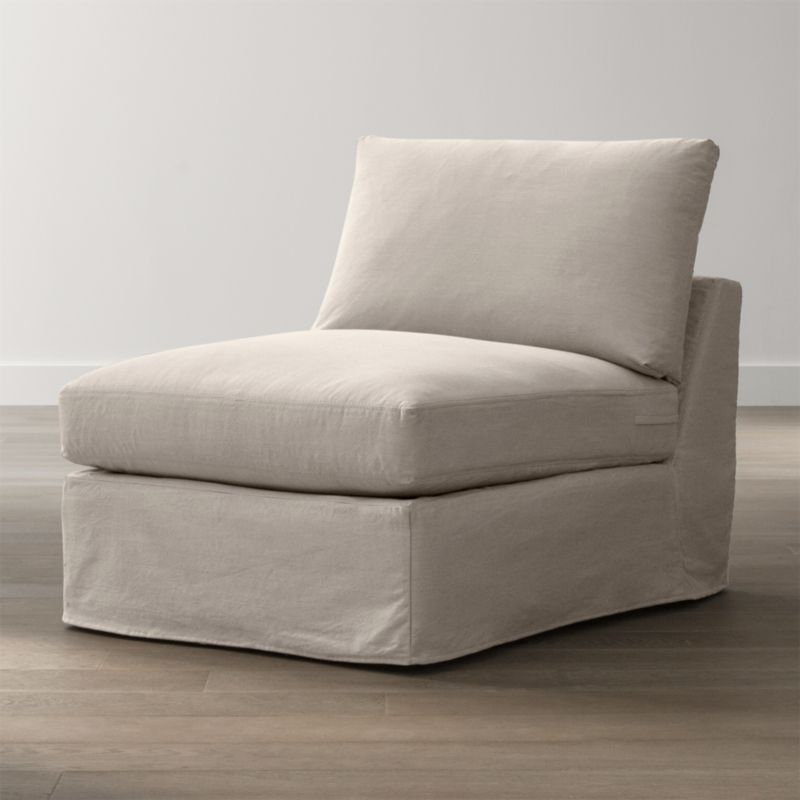 "Tailored to fit our Lounge Slipcovered 32"" Armless Chair, smart denim slipcover is tailored with a kickpleat skirt and jumbo double topstitch outlining its  plump, deep cushions.<br /><br />Additional <a href=""http://crateandbarrel.custhelp.com/cgi-bin/crateandbarrel.cfg/php/enduser/crate_answer.php?popup=-1&p_faqid=125&p_sid=DMUxFvPi"">slipcovers</a> available below and through stores featuring our Furniture Collection.<br /><br />After you place your order, we will send a fabric swatch via next day air for your final approval. We will contact you to verify both your receipt and approval of the fabric swatch before finalizing your order.<br /><br /><NEWTAG/><ul><li>100% cotton</li><li>Machine washable</li><li>Jumbo contrast saddle stitch detail</li><li>Made in North Carolina, USA</li></ul><br />"