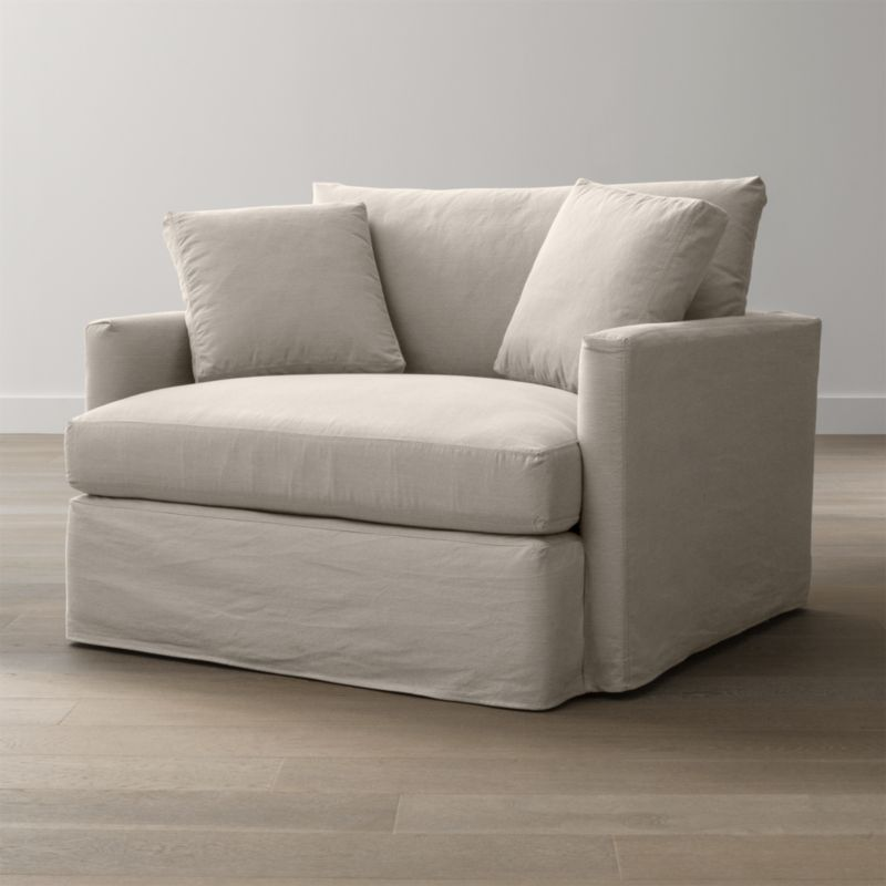 "Tailored to fit our Lounge Chair and a Half, smart denim slipcover is tailored with a kickpleat skirt and jumbo double topstitch outlining its high slim arm and plump, deep cushions.<br /><br />Additional <a href=""http://crateandbarrel.custhelp.com/cgi-bin/crateandbarrel.cfg/php/enduser/crate_answer.php?popup=-1&p_faqid=125&p_sid=DMUxFvPi"">slipcovers</a> available below and through stores featuring our Furniture Collection.<br /><br />After you place your order, we will send a fabric swatch via next day air for your final approval. We will contact you to verify both your receipt and approval of the fabric swatch before finalizing your order.<br /><br /><NEWTAG/><ul><li>100% cotton</li><li>Machine washable</li><li>Jumbo contrast saddle stitch detail</li><li>Made in North Carolina, USA</li></ul><br />"