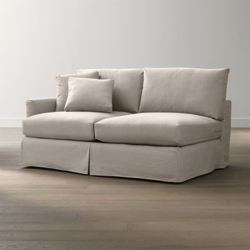 "Tailored to fit our Lounge Slipcovered Left Arm Apartment Sofa, smart denim slipcover is tailored with a kickpleat skirt and jumbo double topstitch outlining its high slim arm and plump, deep cushions.<br /><br />Additional <a href=""http://crateandbarrel.custhelp.com/cgi-bin/crateandbarrel.cfg/php/enduser/crate_answer.php?popup=-1&p_faqid=125&p_sid=DMUxFvPi"">slipcovers</a> available below and through stores featuring our Furniture Collection.<br /><br />After you place your order, we will send a fabric swatch via next day air for your final approval. We will contact you to verify both your receipt and approval of the fabric swatch before finalizing your order.<br /><br /><NEWTAG/><ul><li>100% cotton</li><li>Machine washable</li><li>Jumbo contrast topstitching detail</li><li>Made in North Carolina, USA</li></ul><br />"