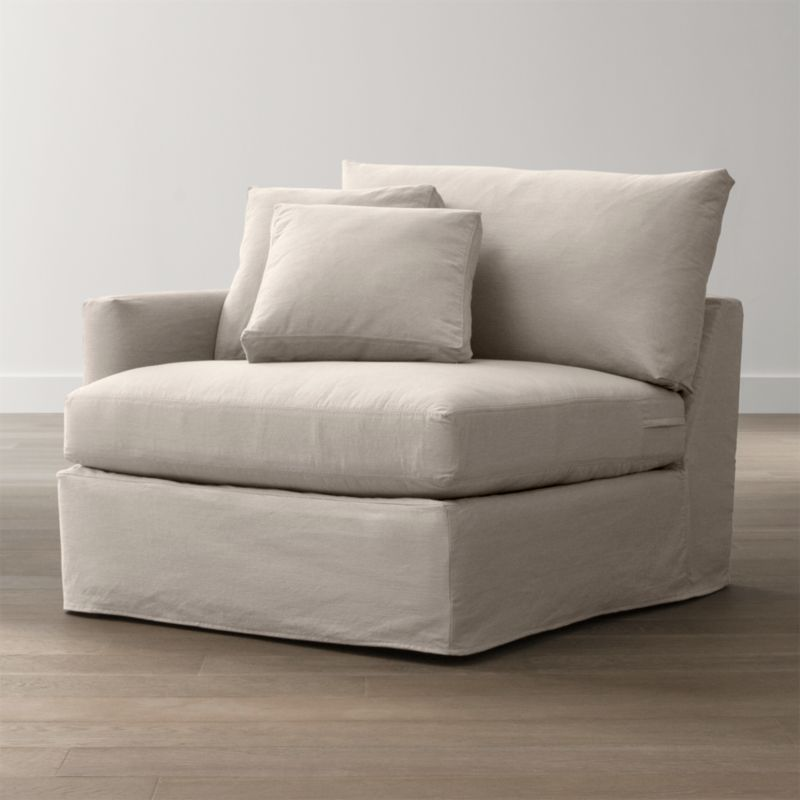 "Tailored to fit our Lounge Left Arm Chair, smart denim slipcover is tailored with a kickpleat skirt and jumbo double topstitch outlining its high slim arm and plump, deep cushions.<br /><br />Additional <a href=""http://crateandbarrel.custhelp.com/cgi-bin/crateandbarrel.cfg/php/enduser/crate_answer.php?popup=-1&p_faqid=125&p_sid=DMUxFvPi"">slipcovers</a> available below and through stores featuring our Furniture Collection.<br /><br />After you place your order, we will send a fabric swatch via next day air for your final approval. We will contact you to verify both your receipt and approval of the fabric swatch before finalizing your order.<br /><br /><NEWTAG/><ul><li>100% cotton</li><li>Machine washable</li><li>Jumbo contrast saddle stitch detail</li><li>Made in North Carolina, USA</li></ul><br />"