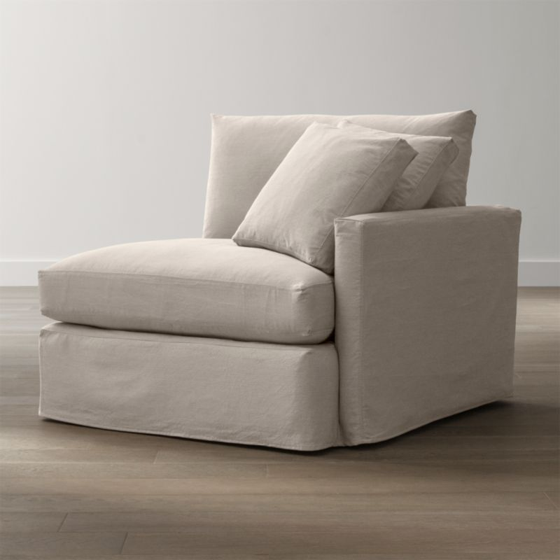 "Tailored to fit our Lounge Right Arm Chair, smart denim slipcover is tailored with a kickpleat skirt and jumbo double topstitch outlining its high slim arm and plump, deep cushions.<br /><br />Additional <a href=""http://crateandbarrel.custhelp.com/cgi-bin/crateandbarrel.cfg/php/enduser/crate_answer.php?popup=-1&p_faqid=125&p_sid=DMUxFvPi"">slipcovers</a> available below and through stores featuring our Furniture Collection.<br /><br />After you place your order, we will send a fabric swatch via next day air for your final approval. We will contact you to verify both your receipt and approval of the fabric swatch before finalizing your order.<br /><br /><NEWTAG/><ul><li>100% cotton</li><li>Machine washable&"
