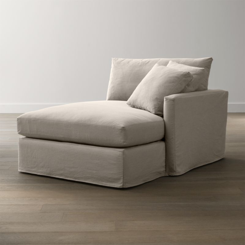 "Tailored to fit our Lounge Slipcovered Left Arm Chaise, smart denim slipcover is tailored with a kickpleat skirt and jumbo double topstitch outlining its high slim arm and plump, deep cushions.<br /><br />Additional <a href=""http://crateandbarrel.custhelp.com/cgi-bin/crateandbarrel.cfg/php/enduser/crate_answer.php?popup=-1&p_faqid=125&p_sid=DMUxFvPi"">slipcovers</a> available below and through stores featuring our Furniture Collection.<br /><br />After you place your order, we will send a fabric swatch via next day air for your final approval. We will contact you to verify both your receipt and approval of the fabric swatch before finalizing your order.<br /><br /><NEWTAG/><ul><li>100% cotton</li><li>Machine washable</li>&l"