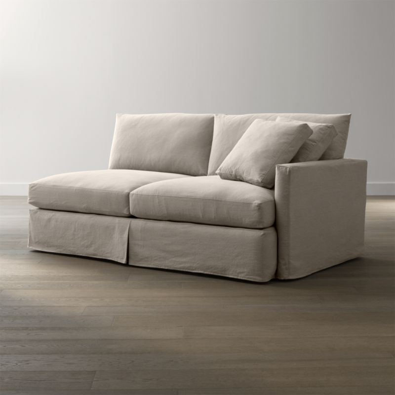 "Tailored to fit our Lounge Slipcovered Right Arm Sofa, smart denim slipcover is tailored with a kickpleat skirt and jumbo double topstitch outlining its high slim arm and plump, deep cushions.<br /><br />Additional <a href=""http://crateandbarrel.custhelp.com/cgi-bin/crateandbarrel.cfg/php/enduser/crate_answer.php?popup=-1&p_faqid=125&p_sid=DMUxFvPi"">slipcovers</a> available below and through stores featuring our Furniture Collection.<br /><br />After you place your order, we will send a fabric swatch via next day air for your final approval. We will contact you to verify both your receipt and approval of the fabric swatch before finalizing your order.<br /><br /><NEWTAG/><ul><li>100% cotton</li><li>Machine washable</li><li>Jumbo contrast saddle stitch detail</li><li>Made in North Carolina, USA</li></ul><br />"