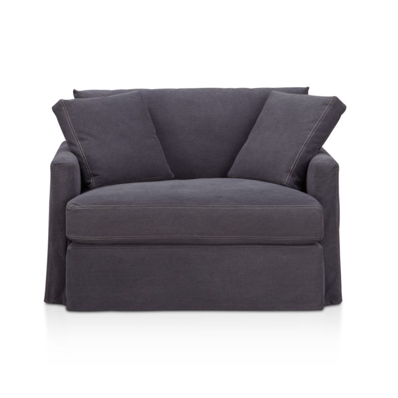"Tailored to fit our Lounge Slipcovered Chair and a Half, smart denim slipcover is tailored with a kickpleat skirt and jumbo double topstitch outlining its high slim arms and plump, deep cushions.<br /><br />Additional <a href=""http://crateandbarrel.custhelp.com/cgi-bin/crateandbarrel.cfg/php/enduser/crate_answer.php?popup=-1&p_faqid=125&p_sid=DMUxFvPi"">slipcovers</a> available below and through stores featuring our Furniture Collection.<br /><br />After you place your order, we will send a fabric swatch via next day air for your final approval. We will contact you to verify both your receipt and approval of the fabric swatch before finalizing your order.<br /><br /><NEWTAG/><ul><li>100% cotton</li><li>Machine washable</li><li>Jumbo contrast topstitching detail</li><li>Made in North Carolina, USA</li></ul><br />"