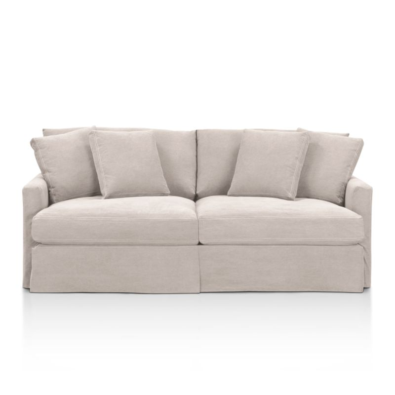 "A Casual Friday dress code for our popular, laid-back Lounge Collection. Smart dove grey denim slipcover is tailored with a kickpleat skirt and matching jumbo double topstitch outlining its high, slim arms and plump, deep cushions.<br /><br />Additional <a href=""http://crateandbarrel.custhelp.com/cgi-bin/crateandbarrel.cfg/php/enduser/crate_answer.php?popup=-1&p_faqid=125&p_sid=DMUxFvPi"">slipcovers</a> available below and through stores featuring our Furniture Collection.<br /><br />After you place your order, we will send a fabric swatch via next day air for your final approval. We will contact you to verify both your receipt and approval of the fabric swatch before finalizing your order.<br /><br /><NEWTAG/><ul><li>Eco-friendly construction</li><li>Certified sustainable, kiln-dried hardwood frame</li><li>Seat cushions are multi-layer soy- or plant-based poly foam wrapped in fiber down blend and encased in downproof ticking</li><li>Back cushions are fiber down in downproof ticking</li><li>100% cotton slipcover</li><li>Removable slipcovers are machine washable</li><li>Jumbo contrast topstitching detail</li><li>Flexolator spring suspension</li><li>Benchmade</li><li>Made in North Carolina, USA</li></ul>"
